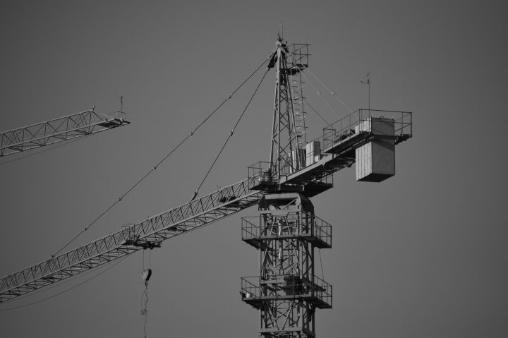 A crane, towering over the bustling city.